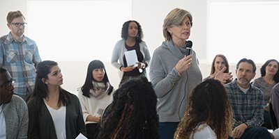Woman speaking to a group of students